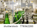 bottles with champagne wine are ... | Shutterstock . vector #778362283