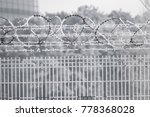 barb wire fence at the cold... | Shutterstock . vector #778368028