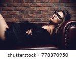 seductive girl in the black...   Shutterstock . vector #778370950