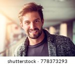 one handsome young man in urban ... | Shutterstock . vector #778373293