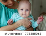 mother holding her child. young ... | Shutterstock . vector #778385068