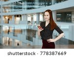 the young business woman talks... | Shutterstock . vector #778387669
