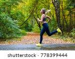 woman running in the autumn park | Shutterstock . vector #778399444
