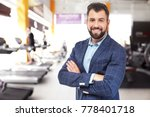 owner of business in his gym | Shutterstock . vector #778401718