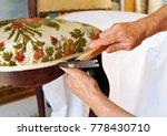 upholsterer repairs an antique... | Shutterstock . vector #778430710