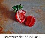 juicy cut strawberry.... | Shutterstock . vector #778431040