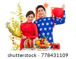 cheerful vietnamese couple... | Shutterstock . vector #778431109