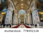 Small photo of Rome, Vatican City State - December 2, 2017: Tourists are enjoying the rich sights and decorations of the interior of St.Peters Basilica