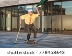 playful grandfather is rolling... | Shutterstock . vector #778458643