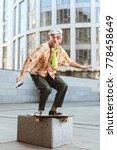 grandpa on a skateboard jumps... | Shutterstock . vector #778458649