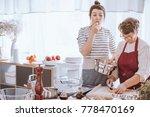 granddaughter eating pasta... | Shutterstock . vector #778470169