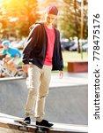 teenage boy skateboarding... | Shutterstock . vector #778475176