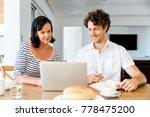 happy modern couple working on... | Shutterstock . vector #778475200