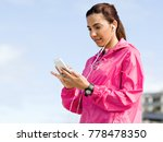 sporty woman with earphones on... | Shutterstock . vector #778478350