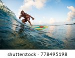 young surfer rides ocean wave... | Shutterstock . vector #778495198