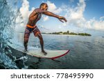 asian professional surfer rides ... | Shutterstock . vector #778495990