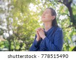 woman pray  in the garden ... | Shutterstock . vector #778515490