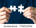 hands connecting jigsaw puzzle. ... | Shutterstock . vector #778522546