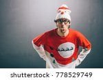 moody man sticking his tongue... | Shutterstock . vector #778529749