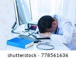 doctor man worried on desk | Shutterstock . vector #778561636