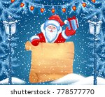 santa claus holds parchment for ... | Shutterstock .eps vector #778577770