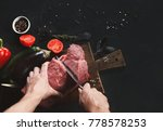 man slicing filet mignon on... | Shutterstock . vector #778578253