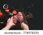 man slicing filet mignon on...   Shutterstock . vector #778578253