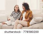 two happy female friends using... | Shutterstock . vector #778580200