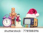 retro tv in santa hat with 2018 ... | Shutterstock . vector #778588396