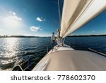 a couple in love on a yacht.... | Shutterstock . vector #778602370