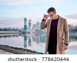 man in coat walks along the... | Shutterstock . vector #778620646