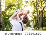 father lifting up his baby... | Shutterstock . vector #778641610