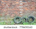 old tyres in front of old brick ... | Shutterstock . vector #778650163