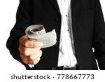 business man holding money on...   Shutterstock . vector #778667773