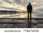 man standing at the shore ... | Shutterstock . vector #778676458