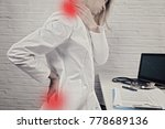 woman suffering from back and...   Shutterstock . vector #778689136