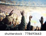 football fans clapping on the... | Shutterstock . vector #778693663