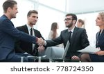 partners concluding deal and... | Shutterstock . vector #778724350