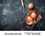 raw chicken eggs and whisk. top ...   Shutterstock . vector #778736368