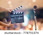 man hands holding movie clapper.... | Shutterstock . vector #778751374