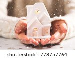 female hands holding and saving ... | Shutterstock . vector #778757764