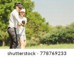 asian couple playing golf. man... | Shutterstock . vector #778769233