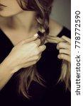 close up woman hands braiding... | Shutterstock . vector #778772590
