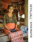 Small photo of Mauliru, Haumara, Waingapu, East Sumba, East Nusa Tenggara, Indonesia - November 2017 : Proud Sumbanese woman coordinating the ladies of the village in their weaving activities