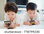 Two  Chinese Children Addicted...