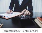 man using calculator and... | Shutterstock . vector #778817554