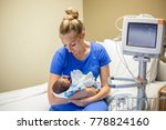 young mother holding her... | Shutterstock . vector #778824160