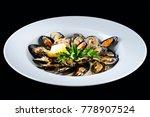 shellfish mussels. baked... | Shutterstock . vector #778907524