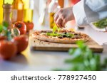 closeup on chef's hands laying... | Shutterstock . vector #778927450