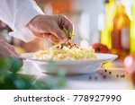 close up on the hand of a chef... | Shutterstock . vector #778927990